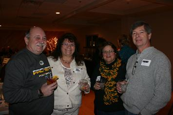 Club members Bruce and Marilyn Karow and Kim & Al Lobdell enjoy a break in the pre-dinner social hour by posing for a photo.