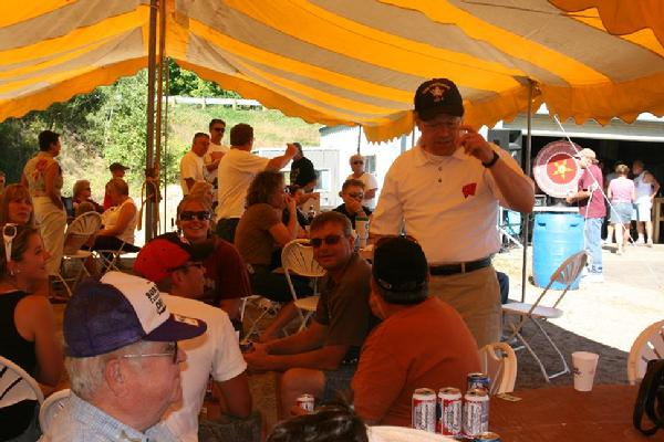 """Red Arrow members, guests and local citizens enjoy """"an afternoon under the tent"""" at the annual Corn Roast held on the Saturday of Labor Day weekend."""