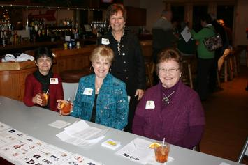 Party Committee members Linda Brantmeier, Janet Bies, Mary Vanderverren and Mary Stehula (standing) did a great job of decorating the room and getting guests checked in!!