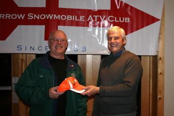 Club President John Brantmeier presents Tim Sass, President of the Sheboygan Falls snowmobile club with Tim's hat that John found on the trail. It was a little worse for wear with some stud holes in the brim but Tim was glad to get it back.